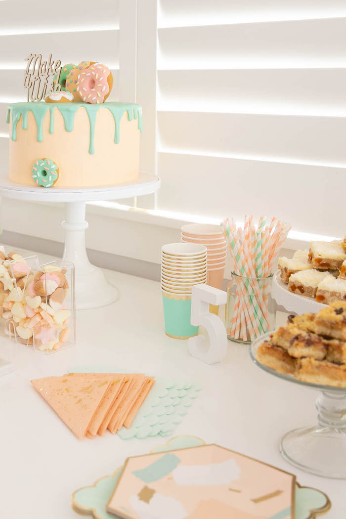 Peach and mint donut themed party table from a DIY Peach & Mint Donut Party on Kara's Party Ideas | KarasPartyIdeas.com