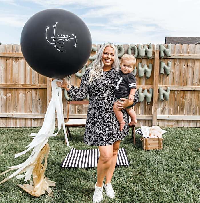 Football Play-inspired Jumbo Black Balloon from a 1st Birthday Football Party on Kara's Party Ideas | KarasPartyIdeas.com (24)