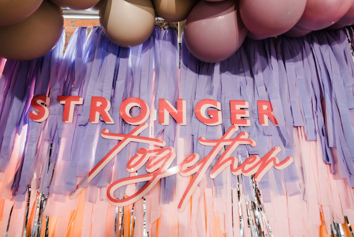 "Stronger Together Tassel Streamer Backdrop from a ""We are Stronger Together"" Party on Kara's Party Ideas 