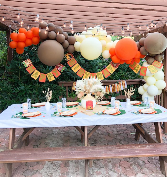 Lion King-inspired Kid Table from a Boho Lion King Birthday Party on Kara's Party Ideas | KarasPartyIdeas.com (16)