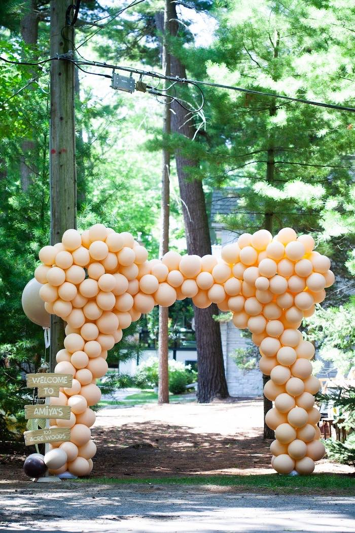 Winnie the Pooh Ear Balloon Arch from a Hundred Acre Wood Winnie the Pooh Party on Kara's Party Ideas | KarasPartyIdeas.com (37)