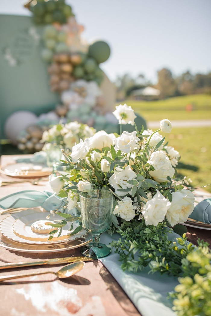 "White Floral Centerpiece + Greenery from a ""Baby in Bloom"" Outdoor Baby Shower on Kara's Party Ideas 