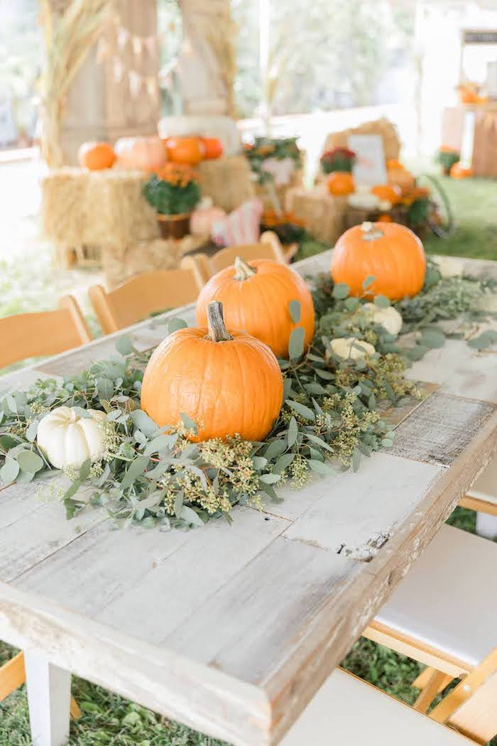 Guest table lined with Pumpkins & Greenery from a Little Pumpkin Birthday Party on Kara's Party Ideas | KarasPartyIdeas.com (28)