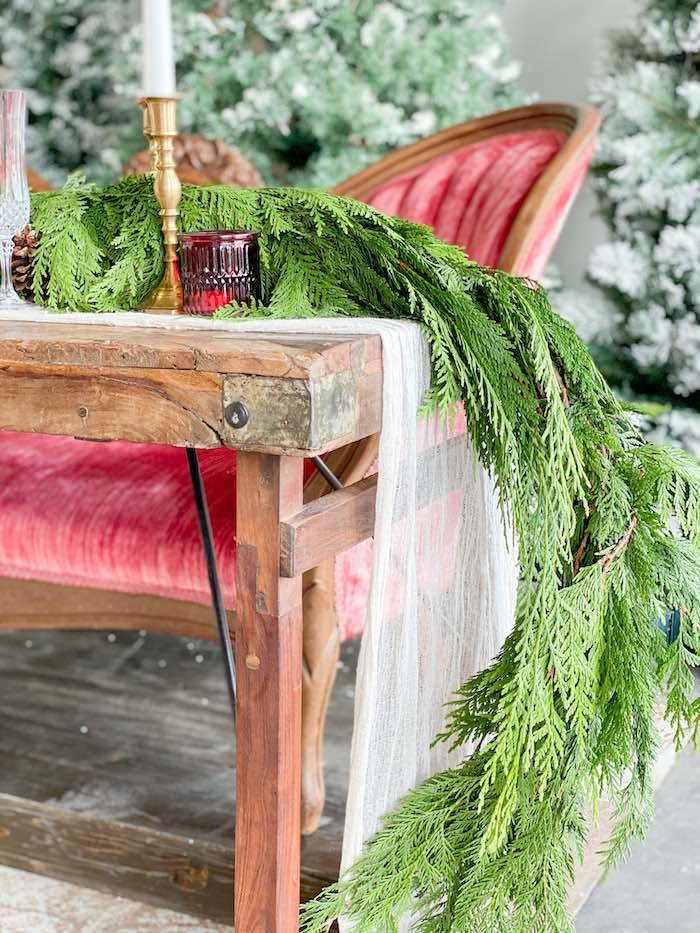 Rustic Wood Table lined with Pine Garland from a Luxe Christmas Dinner on Kara's Party Ideas | KarasPartyIdeas.com (15)