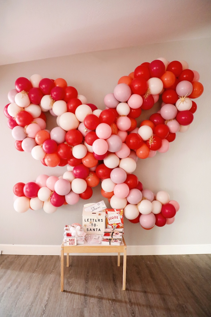 Bow Balloon Install + Letters to Santa Favor Table from a Naughty & Nice Christmas Inspired Birthday Party on Kara's Party Ideas | KarasPartyIdeas.com (14)