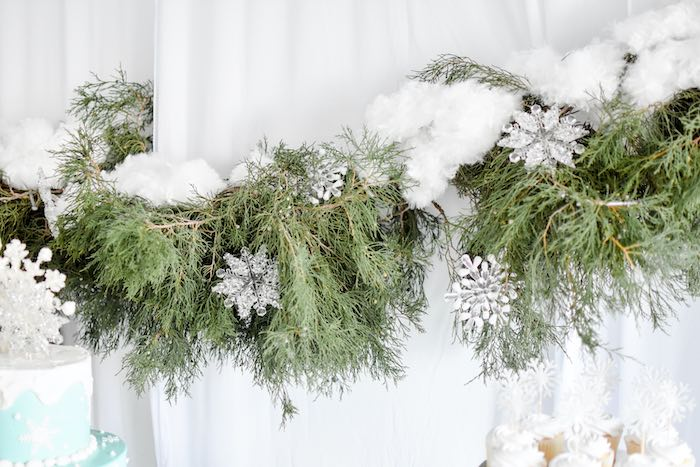 Snowflake-adorned Cedar Garland Backdrop from a Winter ONEderland 1st Birthday Party on Kara's Party Ideas | KarasPartyIdeas.com (69)