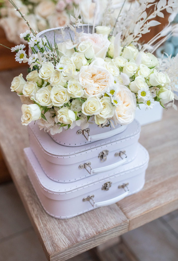 """White Bloom Suitcase Centerpiece from a """"Welcome to the World"""" Travel Baby Shower on Kara's Party Ideas 