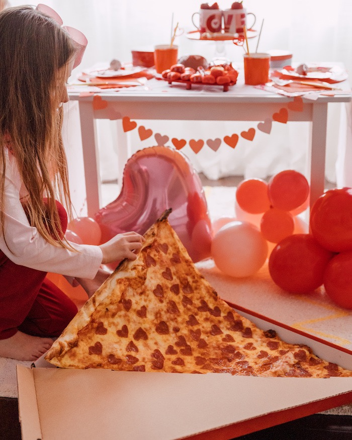 "Giant Pizza Slice adorned with Heart Shaped Pepperoni from a ""Love you to Pizzas"" Valentine's Day Party on Kara's Party Ideas 