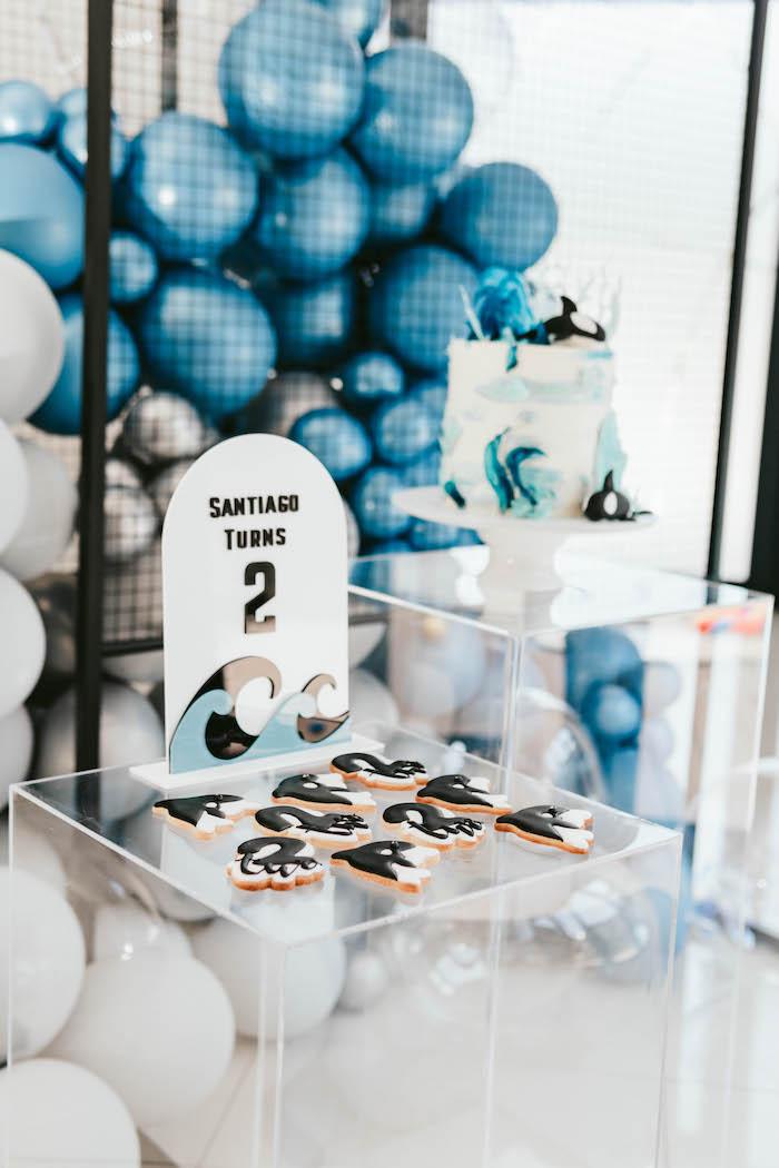 Orca Whale Cookies on an Acrylic Dessert Pedestal from a Monochromatic Orca Whale Birthday Party on Kara's Party Ideas | KarasPartyIdeas.com (3)