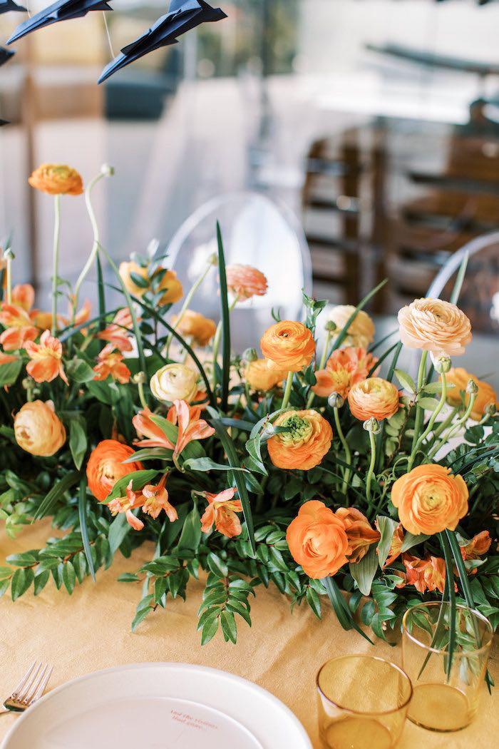 "Orange Floral Centerpiece from a ""Boy Meets World"" Travel Baby Shower on Kara's Party Ideas | KarasPartyIdeas.com (16)"