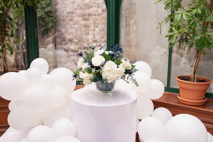 """Floral-accented Pedestal Table in the """"Clouds"""" from a Galaxy Baby Shower on Kara's Party Ideas 