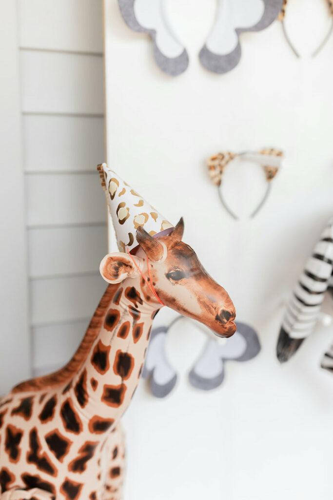 "Inflatable Party Giraffe from a ""ROAR, She's 4!"" Safari Animal Party on Kara's Party Ideas | KarasPartyIdeas.com"