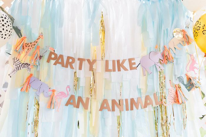 "Party Animal Tassel Streamer Backdrop from a ""ROAR, She's 4!"" Safari Animal Party on Kara's Party Ideas | KarasPartyIdeas.com"