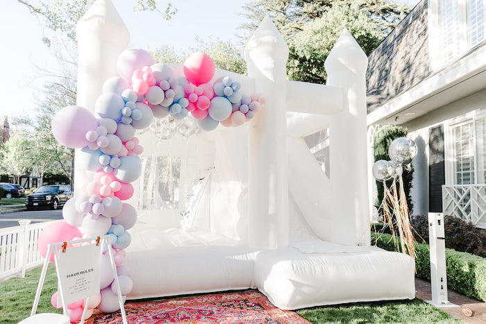 """Balloon-covered Bounce House from a """"Stay Wild, Moon Child"""" Dreamy Birthday Party on Kara's Party Ideas 