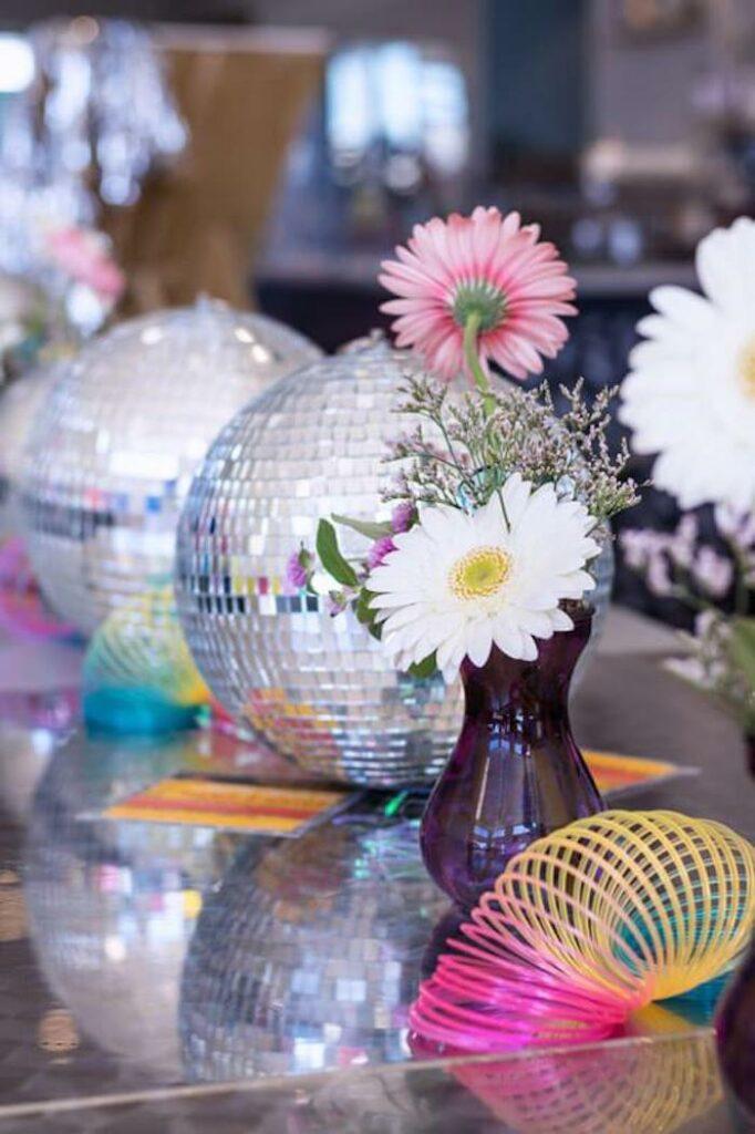 Floral Disco Ball Centerpiece from a Groovy Disco Birthday Party on Kara's Party Ideas | KarasPartyIdeas.com