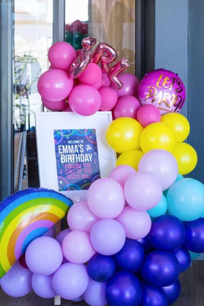 Rainbow Balloon Install Welcome Sign from a Groovy Disco Birthday Party on Kara's Party Ideas | KarasPartyIdeas.com