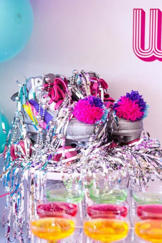 Tinsel-covered Roller Skate Centerpiece from a Groovy Disco Birthday Party on Kara's Party Ideas | KarasPartyIdeas.com
