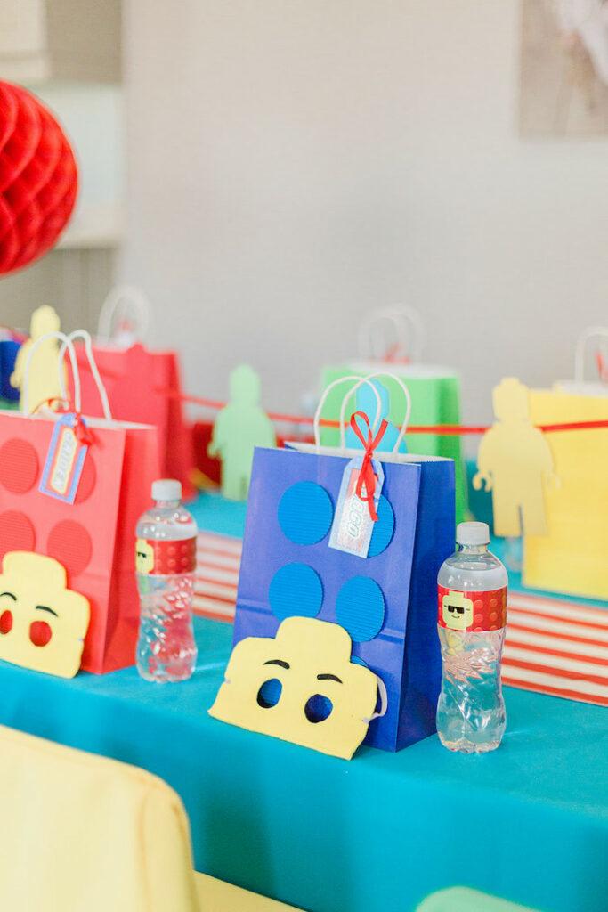 Lego Bag + Mask Table Settings from a Lego Birthday Party on Kara's Party Ideas   KarasPartyIdeas.com