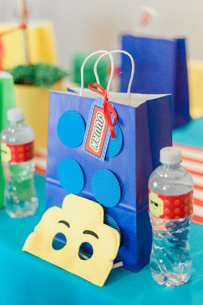 Lego Bag + Mask Table Setting from a Lego Birthday Party on Kara's Party Ideas   KarasPartyIdeas.com