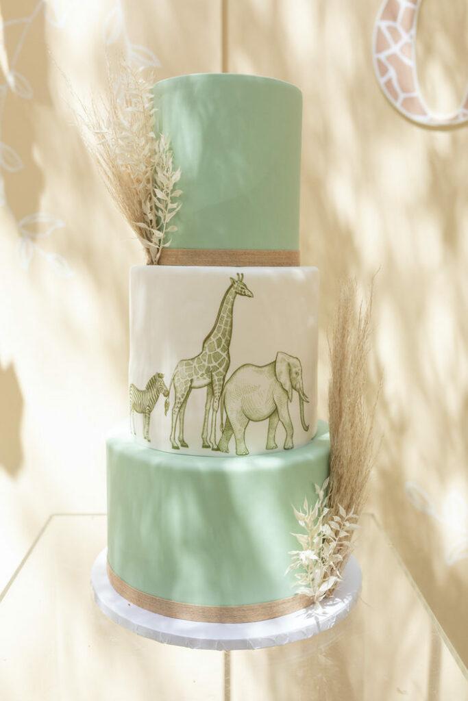 Safari Animal Cake from a Muted Boho Wild ONE Birthday Party on Kara's Party Ideas | KarasPartyIdeas.com