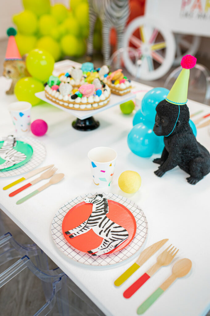 Colorful Wild Animal Kid Table from a Party Like an Animal Birthday Party on Kara's Party Ideas | KarasPartyIdeas.com