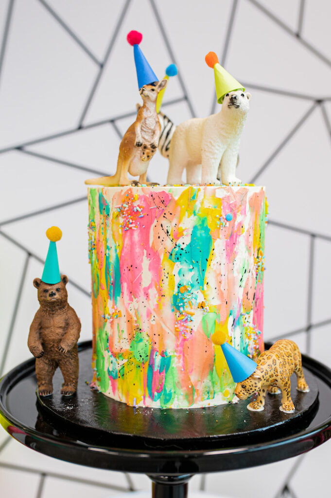 Colorful Wild Animal Splatter Cake from a Party Like an Animal Birthday Party on Kara's Party Ideas | KarasPartyIdeas.com
