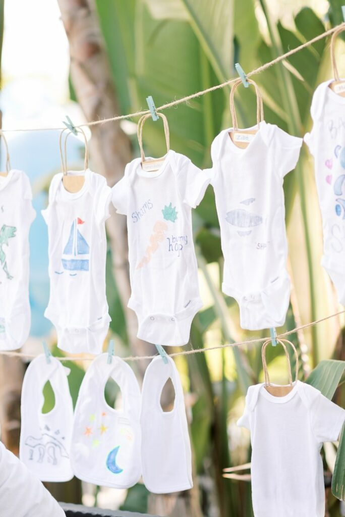 Onesie + Bib Garland from a Baby Backyard Garden Sip and See on Kara's Party Ideas | KarasPartyIdeas.com