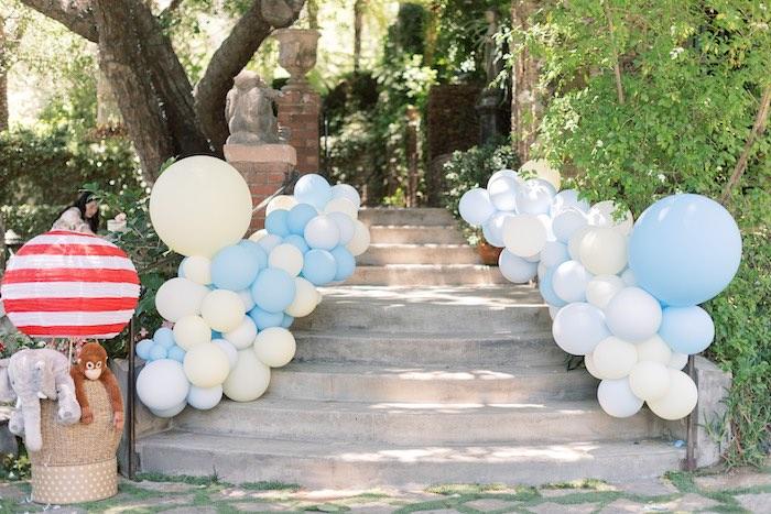 Balloon Garland Walkway from a Baby Backyard Garden Sip and See on Kara's Party Ideas | KarasPartyIdeas.com
