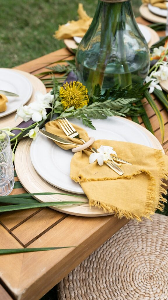 Tropical-inspired Table Setting from a Glam Tropical Backyard Pool Party on Kara's Party Ideas | KarasPartyIdeas.com