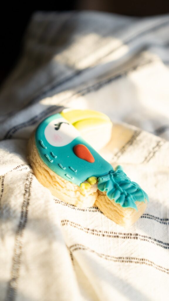 Parrot Cookie from a Glam Tropical Backyard Pool Party on Kara's Party Ideas | KarasPartyIdeas.com