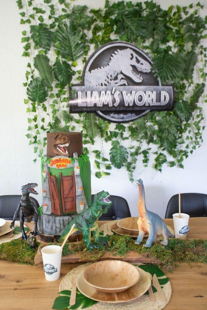 Jurassic Park-inspired Birthday Cake + Kid Table from a Jurassic World Dinosaur Birthday Party on Kara's Party Ideas   KarasPartyIdeas.com