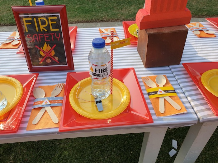 """Firemen Themed Kid Table Setting from a """"Stop, Drop and Roll"""" Fireman Party on Kara's Party Ide"""