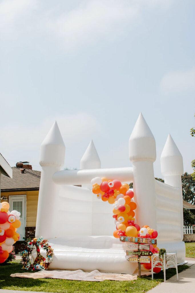 Boho Bounce House from a Boho Floral Woodstock Inspired Birthday Party on Kara's Party Ideas   KarasPartyIdeas.com