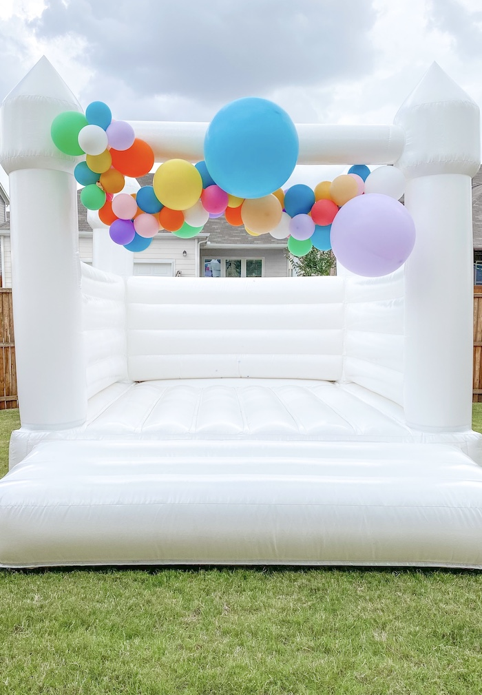 Colorful Balloon Garland Bounce House from a Colorful Party Animals Birthday Party on Kara's Party Ideas | KarasPartyIdeas.com