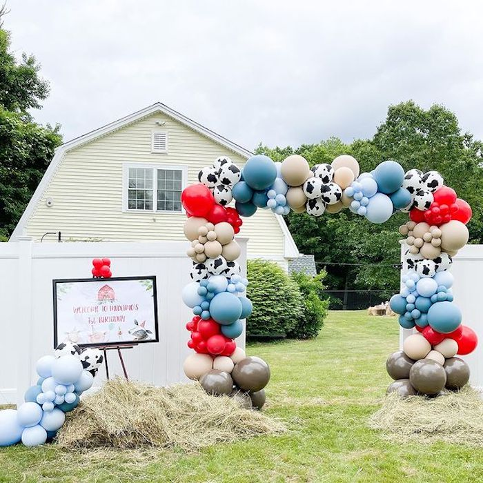 Farm Themed Balloon Arch Party Entrance from a Farm 1st Birthday Party on Kara's Party Ideas | KarasPartyIdeas.com