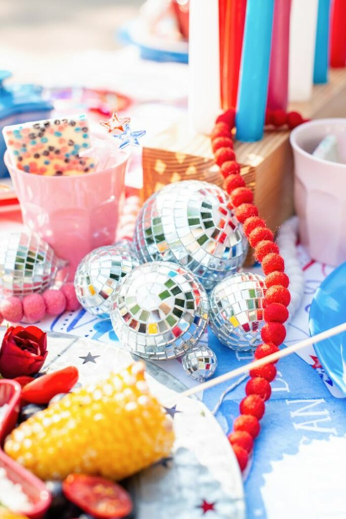 Disco Balls & Pom Bunting from a Modern Americana 4th of July Party on Kara's Party Ideas | KarasPartyIdeas.com