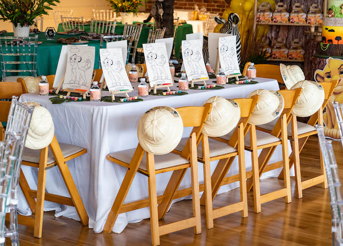 Lion King Kid + Art Table from a Lion King Birthday Party via Kara's Party Ideas | KarasPartyIdeas.com