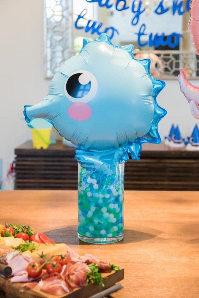 Seahorse Balloon Table Centerpiece from a Baby Shark Birthday Party on Kara's Party Ideas | KarasPartyIdeas.com