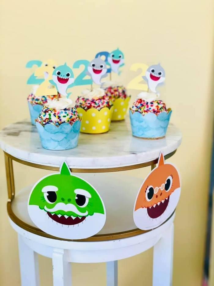 Baby Shark Cupcakes + Pedestal Table from a Baby Shark Birthday Party on Kara's Party Ideas | KarasPartyIdeas.com