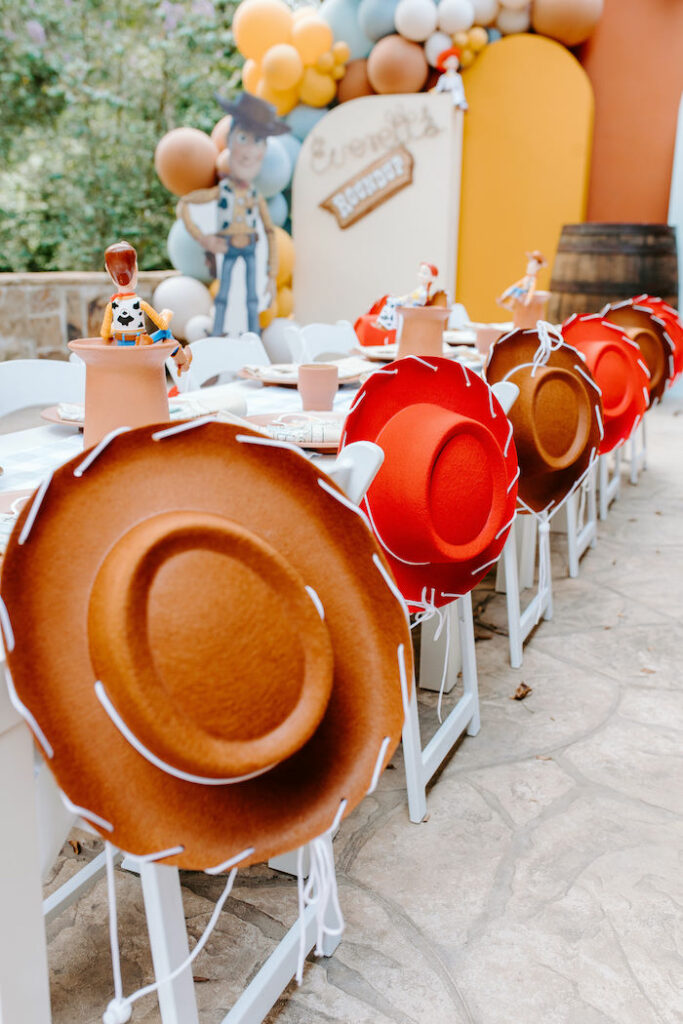 Kid Chairs adorned with Woody + Jessie Hats from a Toy Story Inspired Cowboy Roundup Party on Kara's Party Ideas | KarasPartyIdeas.com