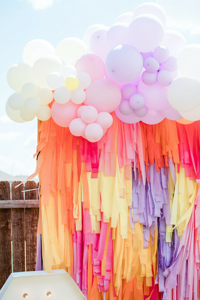 """Groovy Tassel Streamer Backdrop from a Groovy """"Young, Wild and THREE"""" Party on Kara's Party Ideas 
