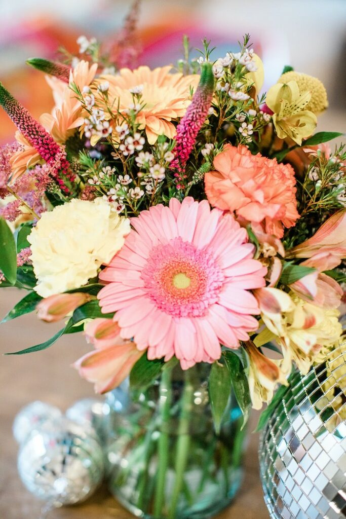 """Floral Arrangement from a Groovy """"Young, Wild and THREE"""" Party on Kara's Party Ideas 
