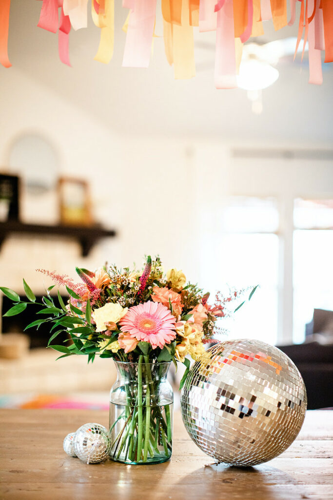 """Disco Ball & Bloom Centerpiece from a Groovy """"Young, Wild and THREE"""" Party on Kara's Party Ideas 