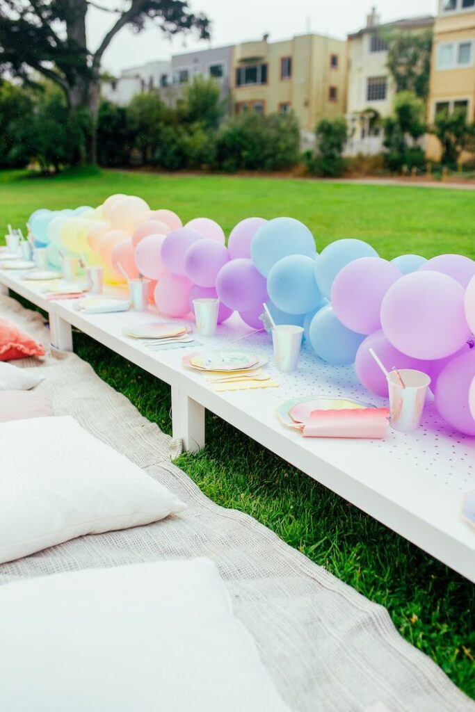 Pastel Rainbow Guest Table from a Pastel Rainbow Bubble Bash on Kara's Party Ideas   KarasPartyIdeas.com