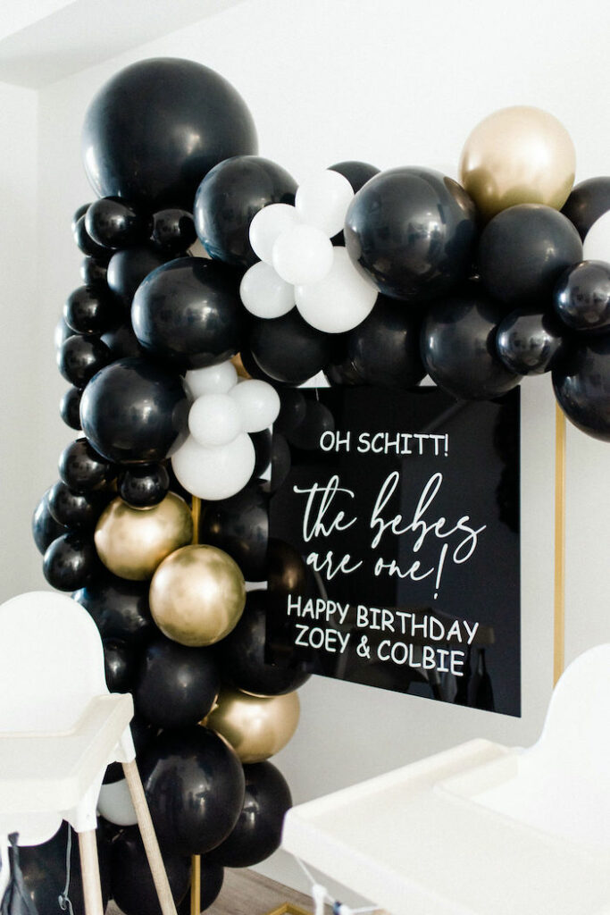 Balloon Garland + Acrylic Sign Backdrop from a Schitt's Creek Inspired 1st Birthday Party on Kara's Party Ideas | KarasPartyIdeas.com