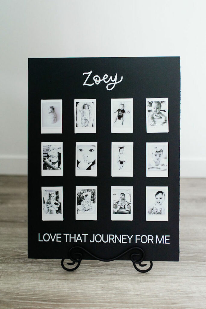 Black + White First Year Photo Board from a Schitt's Creek Inspired 1st Birthday Party on Kara's Party Ideas | KarasPartyIdeas.com